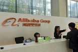 A receptionist talks to a visitor at the headquarters campus of Alibaba Group in Hangzhou, China, on Wednesday.