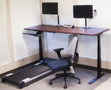 """iMovr's ThermoDesk Elite model is billed as """"the Cadillac of electric height-adjustable desks."""" The desk can adjust to either stand-to-walk size (48"""" or 60"""") or a full sit-to-walk width (72"""" or 83""""). The startup company is offering discount prices on other models during a Kickstarter fundraising campaign that ends Nov. 30, 2014."""