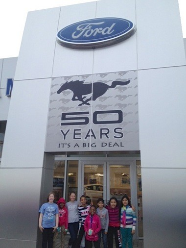 Gresham Ford presented a $1,500 check to staff and youth from the Gresham-area Boys and Girls Clubs.