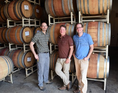 Travis Proctor (left) has been appointed production winemaker at Dobbes Family Estate Winery / Wine by Joe and Andy McVay (far right) has been promoted to associate winemaker for Dundee Vintners. Also pictured is Joe Dobbes (center).