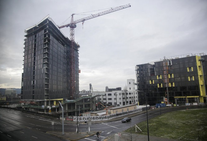This is the 21-story Yard building (left) under construction on the east side of the Burnside Bridge