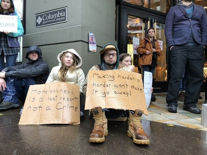 Protesters gathered on Saturday, Dec. 2, 2017, at the entrance of Columbia Sportswear flagship downtown retail store at 911 S.W. Broadway Ave.