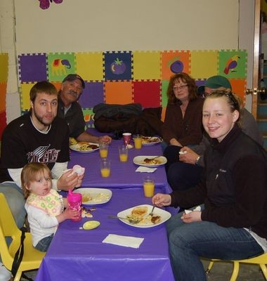 Alaila Mirabella (from left), Joel Mirabella, Ed Middagh, Rose Middagh, Jeff Middagh, and Randi Middagh-Mirabella gather for breakfast at the annual Easter Egg Hunt and Pancake Breakfast at the Carver School in Damascus.