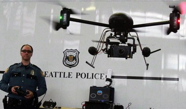 Seattle Police officer Reuben Omelanchuk demonstrates the department's radio-controlled Draganflyer X6 drone before the mayor of Seattle shut the program down over residents' privacy concerns.
