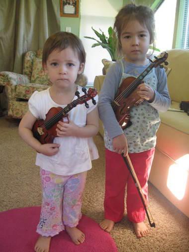 Ellie and Megan Hiserote learn to play the violin through the Suzuki program.