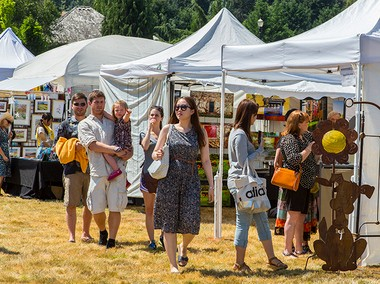 Visitors peruse booths at last year's art festival.