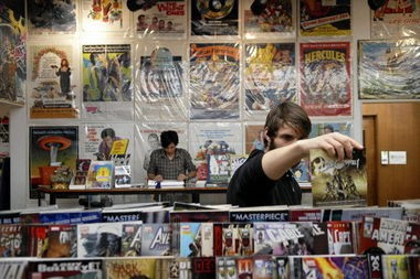 Joel Wasson of Portland grabs a comic book at Floating World Comics. Comic book stores around the country participate in Free Comic Book Day, and so is the West Linn Public Library.