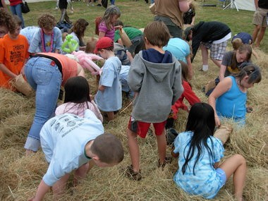 Kids scramble for treats during the free Candy in the Hay hunt at the annual Day in Damascus.