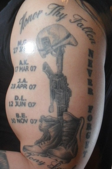 """Victoria Parker's """"Honor Thy Fallen"""" arm tattoo shows the Fallen Soldier Battle Cross next to the initials of five of her brothers-in-arms."""