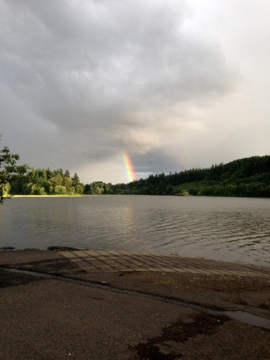 A rainbow juts into the clouds last week near Lacamas Lake. The planned development is designed to preserve the land with a park and trail along the lakeâs shoreline.