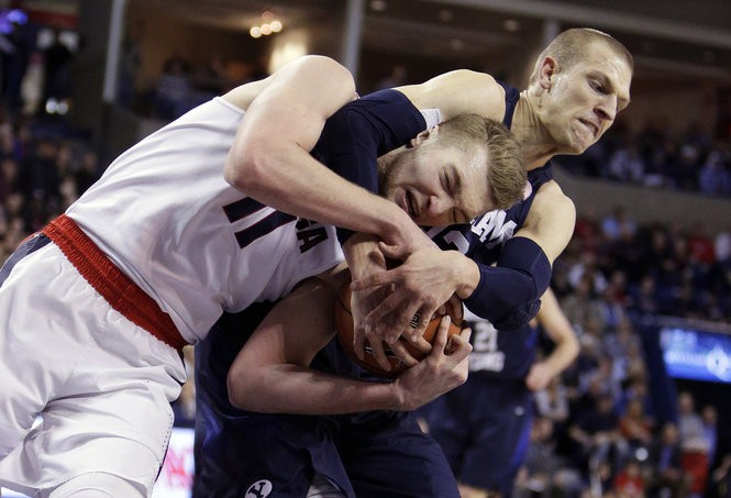 """He plays with so much fire, so much will, so much ambition every possession -- it's amazing,"" Tautvydas Sabonis says of younger brother Domantas (11), here fighting for a rebound against BYU's Nate Austin in January."