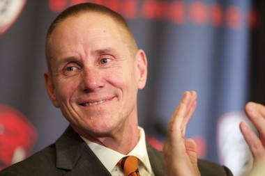 OSU football coach Gary Andersen might have to wait on Wisconsin to fill out his staff.