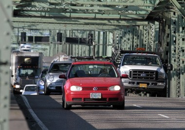 Traffic crosses the Interstate 5 bridge spanning the Columbia River between Oregon and Washington.