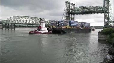 A barge moves up the Columbia River during an I-5 bridge lift.