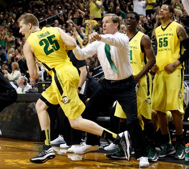 Oregon's E.J. Singler, left, runs downcourt past coach Dana Altman and a celebrating UO bench including Damyean Dotson and Tony Woods after sinking a three-point basket against Washington on Jan. 26.