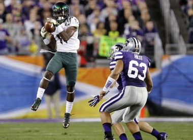 Oregon wide receiver Bralon Addison (11) pulls in a pass as Kansas State's Marcus Heit (63) defends during the first half of the Fiesta Bowl. Addison is one of several young receivers new coach Matt Lubick will try to mold into an impact player.
