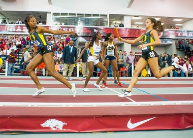 Oregon's Laura Roesler, front right, prepares to hand off the baton to teammate Phyllis Francis, left, during the 4x400-meter relay at the NCAA Division I Indoor Track and Field Championship in Fayetteville, Ark., on Saturday.