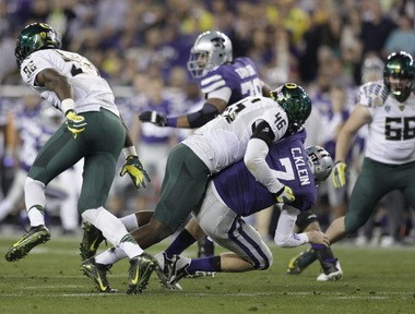 Oregon Ducks linebacker Michael Clay (46) tackles Kansas State Wildcats quarterback Collin Klein (7) for a sack during the first half of the 2013 Tostitos Fiesta Bowl. Clay was named defensive MVP.