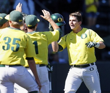 Oregon's Ryon Healy (right) receives congratulations from teammates after his solo home run against Rice on June 2 at PK Park.