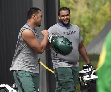 Ducks starting right tackle Tyrell Crosby (right) is the best run-blocking player at his position in the country, according to one ratings service.