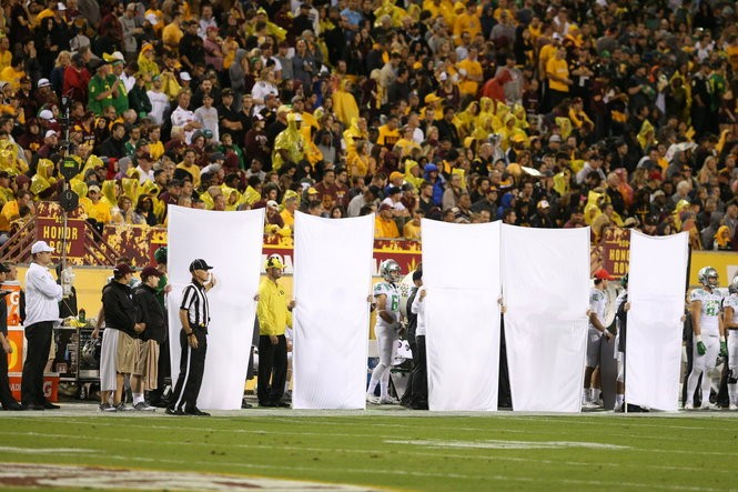 Large barriers are held along the Oregon sideline during the game between the Ducks and Arizona State on Oct. 29, a game Oregon would win, 61-55, in three overtimes.