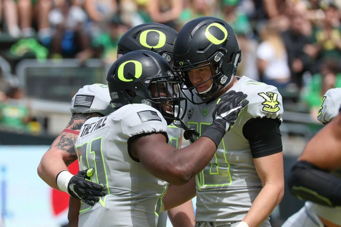 Justin Herbert (10) threw three touchdowns on 16-of-26 passing in the spring game.