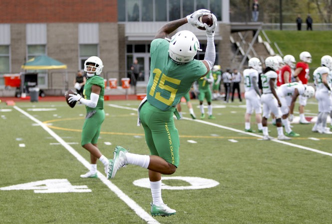 Defensive back Deommodore Lenoir catches a pass during Oregon's spring workout at Portland's Franklin High School. (Sean Meagher/The Oregonian)