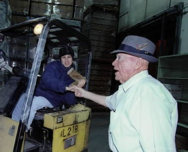 J.R. Simplot enjoys greeting his employees when he tours his holdings. Dalia Herrera, a lift truck driver at Simplot's potato processing plant, meets the boss.