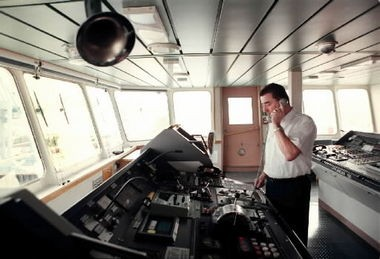 Hans-Jurgen Hinx, the captain of the Dagmar Maersk, plans the route the ship will take across the Pacific to Asia.