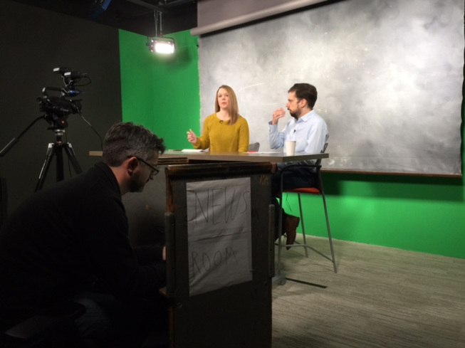 Video producer Dave Killen (left) prepares to shoot a Facebook Live event in the studio inside The Oregonian/OregonLive newsroom. Julie Evensen (center) is preparing to ask reporter Rob Davis (right) questions from readers about his Toxic Armories series that ran last December.