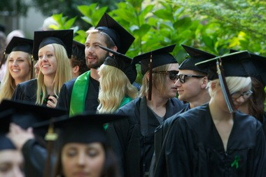Portland State University graduates gather at summer graduation last year. A new study concludes that Portland-area workers earn less than those in other U.S. urban centers because too many have humanities degrees, not enough have business degrees and because white, male college graduates here put in fewer hours at work.