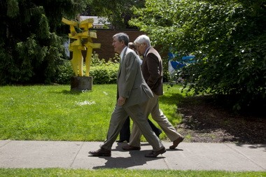 UO President Michael Gottfredson, left, walks across campus with Dave Hubin, senior assistant to the president, and (mostly concealed) Meg Mattson, executive assistant to the vice provost for academic affairs.