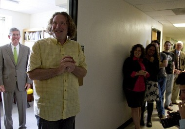 Sociology Professor Richard York expresses surprise and delight at winning the 2013 Herman Award for Distinguished Teaching at the University of Oregon. UO President Michael Gottfredson, who presented it to him, stands as is his wont, out of the spotlight, directing glory back to York and his work.