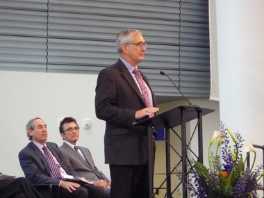 "Portland Mayor Charlie Hales helped inaugurate the new life sciences building. He called it ""A-level work"" and ""a big bold bet on Portland's future."" Behind him are Ken Novack, left, president of a Schnitzer family company which donated the land on which the building stands, and Eugene Skourtes, a dentist who gave $10 million toward the new OHSU dental school that is a major component of the building."