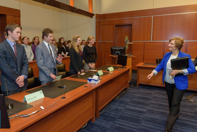 """Oregon Congresswoman Suzanne Bonamici offers compliments to students who argued Constitutional law and principles before her during Saturday's state finals of the """"We the People"""" Constitution competition."""