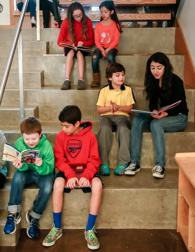 Sixth-graders at Riverdale Grade School read stories with their reading buddies from first- and second-grade. The school helped more than 90 percent of its students to become proficient readers, according to 2017 Smarter Balanced results.