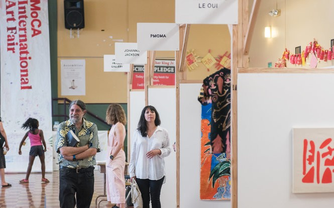 Visitors to the 2017 Converge 45 art festival stroll through the King School Museum of Contemporary Art's International Art Fair.