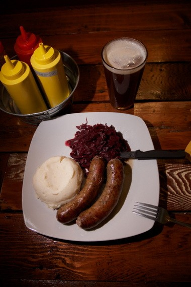 House smoked Hungarian sausage with horseradish and mashed potatoes and Bavarian red cabbage with Apples and red wine at The Slide Inn.