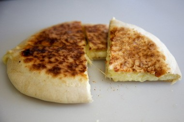 """Kargi Gogo's Khachapuri, or Georgian cheese bread, combines sulguni and feta cheese in an attempt """"to replicate the salty tang of Georgian village cheese,"""" co-owner Sean Fredericks says."""