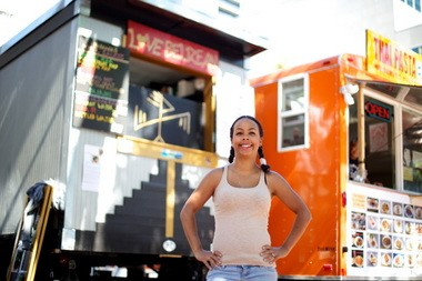 Tiffany Love stands in front of her food cart, Love Belizean.