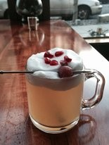 RaciA3n's hot toddy comes with sous vide apple balls and hard cider foam.