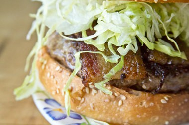 You'll find the kimchi-and-pork-belly-topped Aina Burger on Ate-Oh-Ate's menu alongside macaroni salad and other cheap Hawaiian dishes.