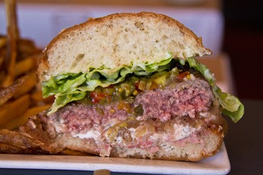A cross-section of Little Bird's perfectly medium rare burger.