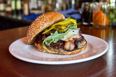 Manchego and romesco grace the irresistible burger at the bustling Toro Bravo.