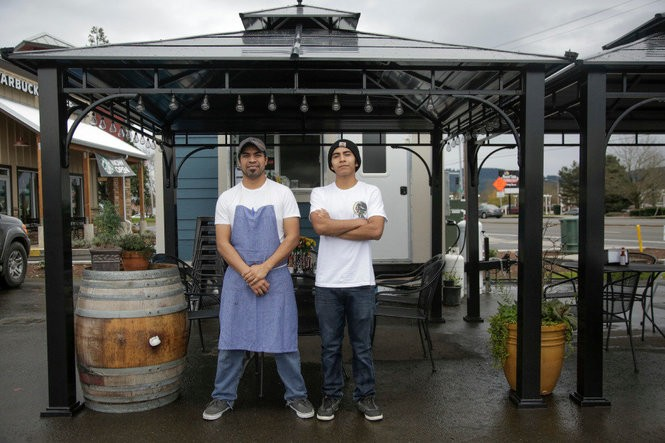 Dos Mundos, a Newberg food cart along Oregon 99W run by Jesus Hernandez (left), Miriam Cuenca and their son Eddie Rodriguez (right).