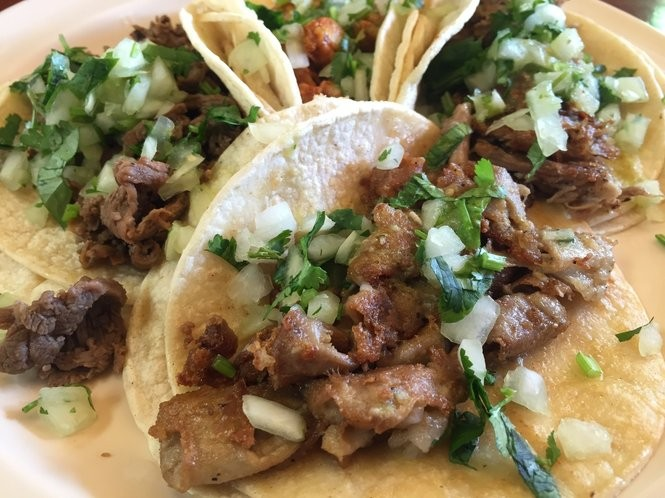 Inexpensive tripe and carnitas tacos from Tigard's Taco Del Sol.