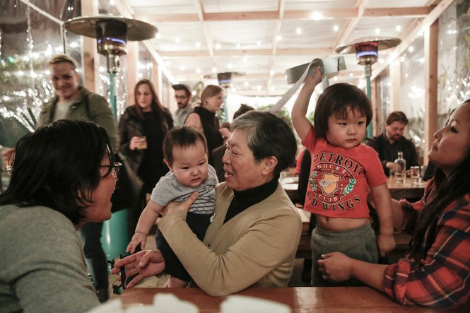 Chef Peter Cho (left), wife Sun Young Park (right) with sons Francis and Elliott and Cho's mother, Myung Cho (center) at Han Oak, The Oregonian's 2017 Restaurant of the Year.