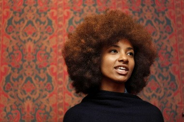 Jazz musician and singer Esperanza Spalding speaks at the Smithsonian's National Museum of American History in Washington, Monday, Oct. 17, 2011, where she donated the dress she wore for her performance at the 2009 Nobel Peace Prize ceremony for President Barack Obama.