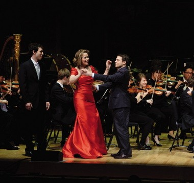 She likes me better than you. Matthew Grills waltzes away with Renee Fleming at a concert at the Eastman School of Music in 2011.