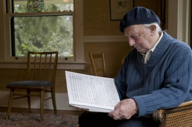"Jacob Avshalomov looks over the score to ""Seasons' Greetings,"" which the Portland Youth Philharmonic played in 2009. He began the work as a surprise wedding anniversary gift for his wife, Doris."